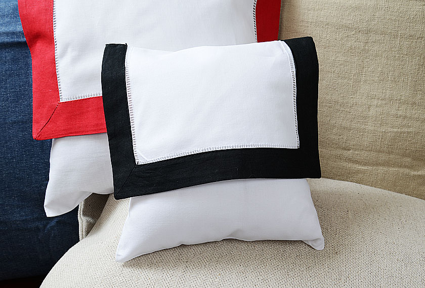 baby envelope pillow, black colored trimmed