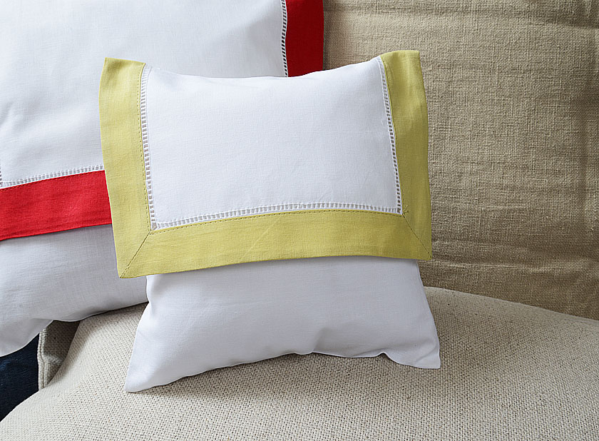 baby envelope pillow, chardonnay colored trimmed