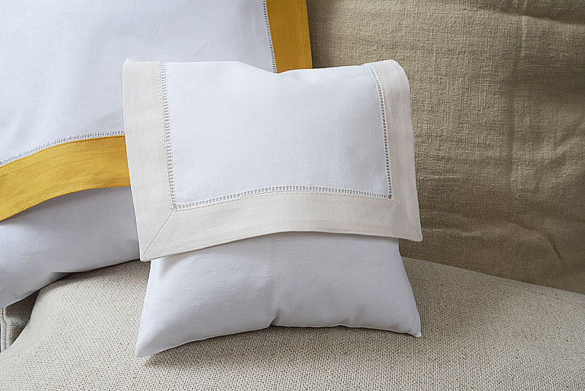 baby envelope pillow, coconut milk colored trimmed