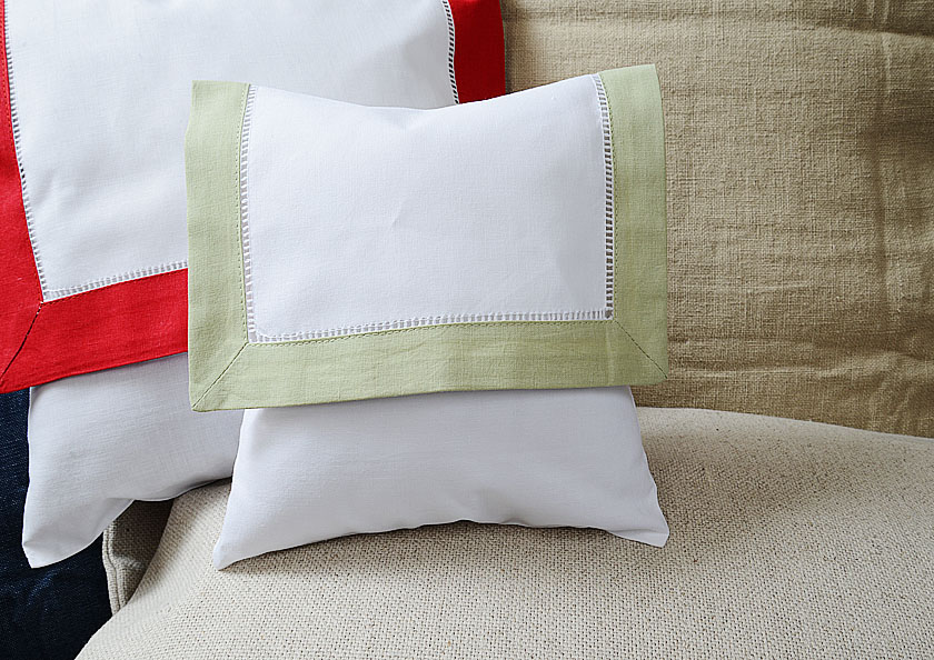 Baby Envelope Pillow, Mellow Green colored trimmed.