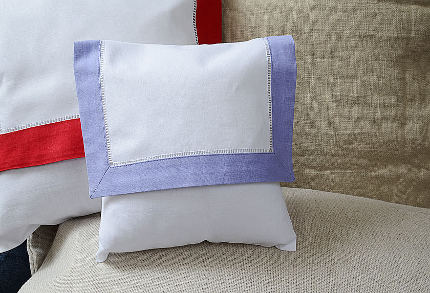 Baby enveope pillow, lavender colored trimmed