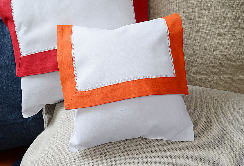 baby envelope pillow, exotic orange colored trimmed