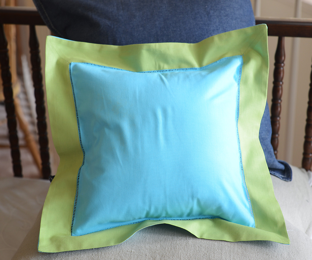 Baby Square Pillow. Multi Colored. Aqua & Hot Green Trimmed
