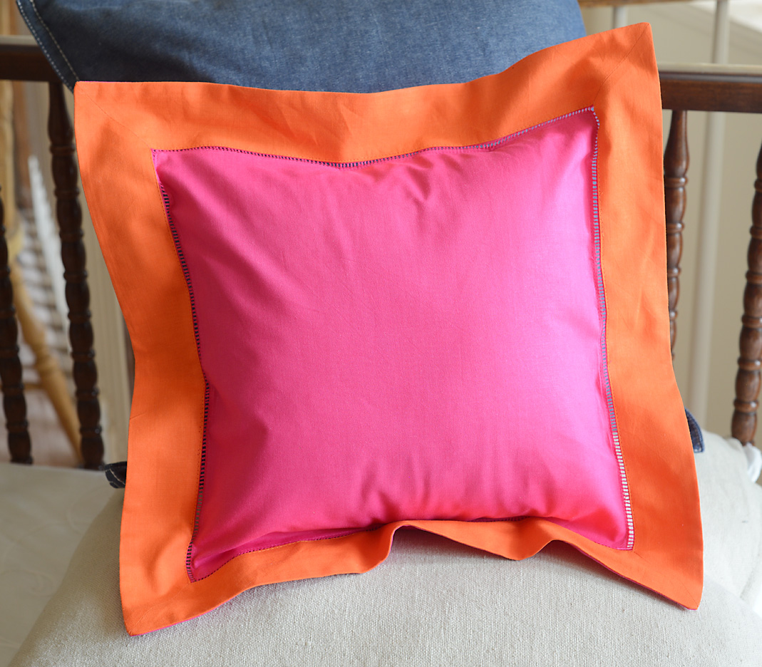 Baby Square Pillow. Multi colored Pink Peacock & Frame Orange