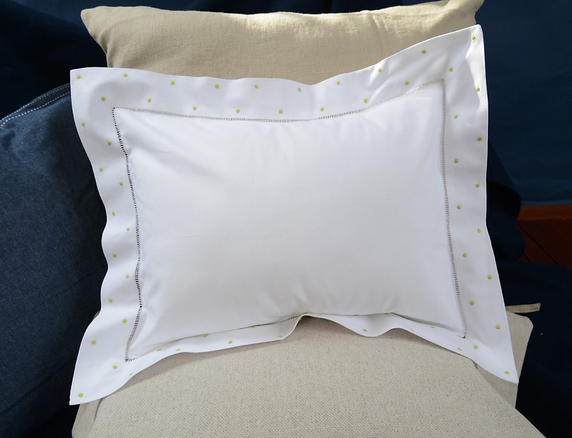 baby pillow green colored polka dots