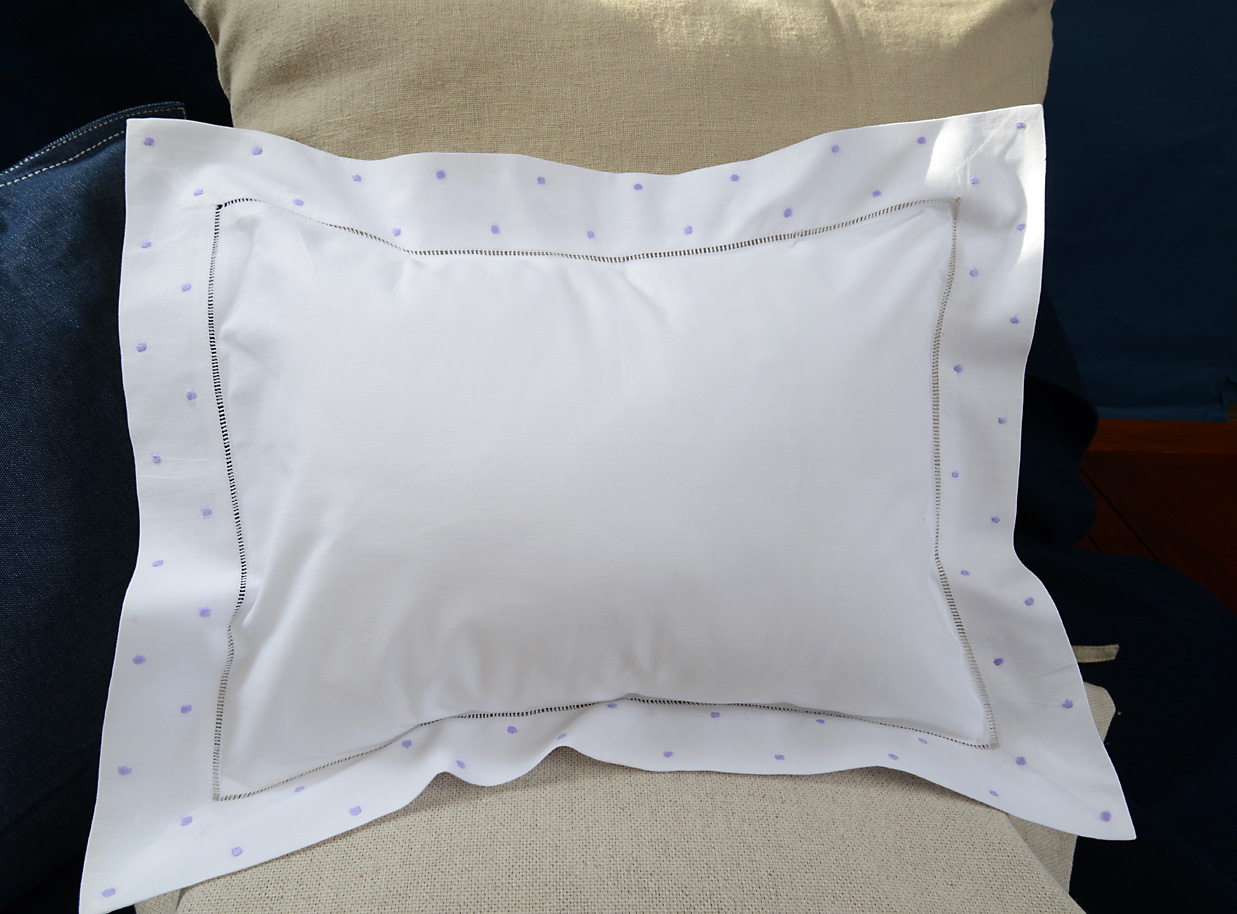 baby pillow with lavender colored polka dots