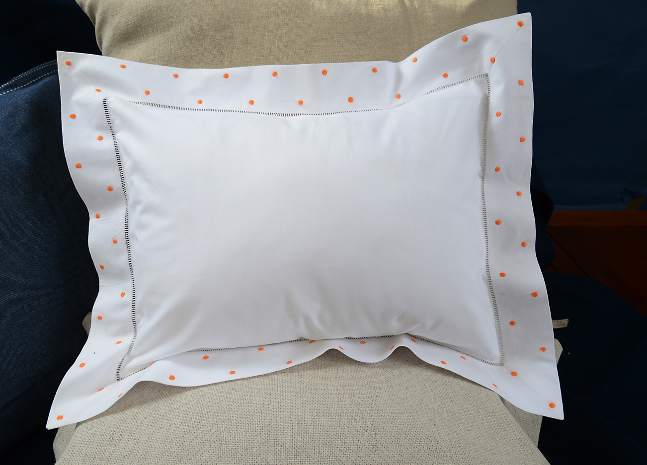 baby pillows orange colored polka dots